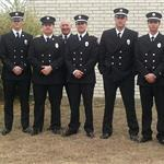 10 members of the Fire Department's A Shift in their formal suits.